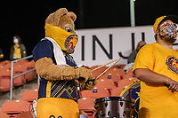SANDY, UT - OCTOBER 03: Utah Royals FC mascot Cleo the Lioness drums during a game between Portland Thorns FC and Utah Royals FC at Rio Tinto Stadium on October 03, 2020 in Sandy, Utah.