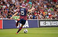AUSTIN, TX - JUNE 16: Megan Rapinoe #15 of the USWNT crosses the ball during a game between Nigeria and USWNT at Q2 Stadium on June 16, 2021 in Austin, Texas.