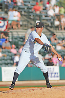 Charleston RiverDogs pitcher Caleb Smith #12 on the mound during a game against the Augusta GreenJackets  at Joseph P. Riley Jr. Ballpark  on April 13, 2014 in Charleston, South Carolina. Augusta defeated Charleston 2-1. (Robert Gurganus/Four Seam Images)