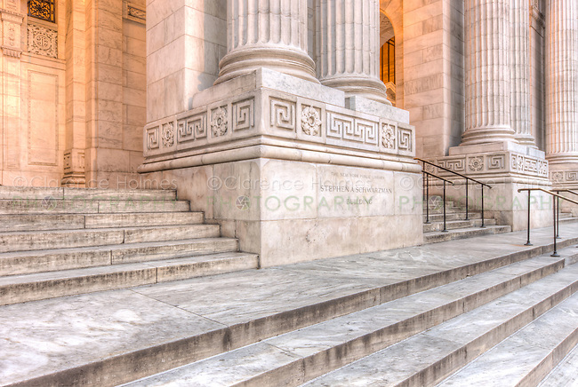 Corinthian columns flank the main entrances to the New York Public Library's Stephen A. Schwarzman Building at the top of stairs leading from 42nd Street in New York City.
