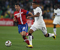 Kevin Prince Boateng (R) of Ghana and Dejan Stankovic (L) of Serbia