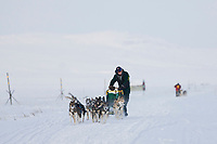Mushers Jeff King, and Mitch Seavey close behind race along the coast of Nome, near the checkpoint of Safety, during the 2008 All Alaska Sweepstakes sled dog race.