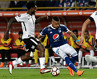 BOGOTA - COLOMBIA – 28 - 02 - 2018: Ayron del Valle (Der.) jugador de Millonarios (COL), disputa el balon con Rene Junior (Izq.) jugador de Corinthians (BRA), durante partido entre Millonarios (COL) y Corinthians (BRA), de la fase de grupos, grupo 7, fecha 1 de la Copa Conmebol Libertadores 2018, en el estadio Nemesio Camacho El Campin, de la ciudad de Bogota. / Ayron del Valle (R) player of Millonarios (COL), figths for the ball with Rene Junior (L) player of Corinthians (BRA), during a match between Millonarios (COL) and Corinthians (BRA), of the group stage, group 7, 1st date for the Conmebol Copa Libertadores 2018 in the Nemesio Camacho El Campin stadium in Bogota city. VizzorImage / Luis Ramirez / Staff.