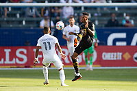 CARSON, CA - MAY 8: Mark-Anthony Kaye #14 of LAFC passes off the ball during a game between Los Angeles FC and Los Angeles Galaxy at Dignity Health Sports Park on May 8, 2021 in Carson, California.