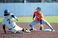 Illinois Fighting Illini second baseman Cal Hejza (13) waits for a throw at second base as Michigan baserunner Jake Marti (7) slides in during the NCAA baseball game on March 19, 2021 at Fisher Stadium in Ann Arbor, Michigan. Illinois won the game 7-4. (Andrew Woolley/Four Seam Images)