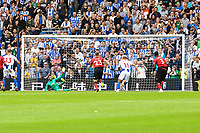 Pascal Gross of Brighton & Hove Albion (13) Scores his teams 3rd goal of the game from the spot  during the Premier League match between Brighton and Hove Albion and Manchester United at the American Express Community Stadium, Brighton and Hove, England on 19 August 2018. Photo by Edward Thomas / PRiME Media Images.