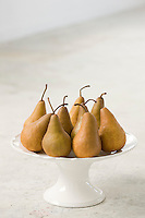 A selection of pears on a white serving dish