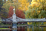 Fall foliage surrounds the Victorian bridge in the Boston Public Garden in Boston, MA, USA