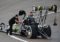 Feb 22, 2014; Chandler, AZ, USA; Two crew members push the car of NHRA top fuel dragster driver Brittany Force during qualifying for the Carquest Auto Parts Nationals at Wild Horse Motorsports Park. Mandatory Credit: Mark J. Rebilas-USA TODAY Sports