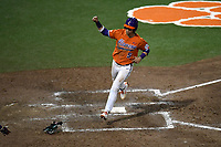 Pinch hitter Sam Hall (5) of the Clemson Tigers crosses the plate with a run in a game against the William and Mary Tribe on February 16, 2018, at Doug Kingsmore Stadium in Clemson, South Carolina. Clemson won, 5-4 in 10 innings. (Tom Priddy/Four Seam Images)