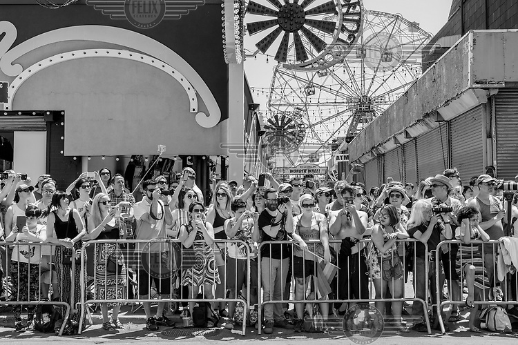 Spectators line the street at the Mermaid Parade in Coney Island.