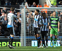Jamaal Lascelles (2nd from left) of Newcastle United celebrates scoring their first goal with team mates during the Barclays Premier League match between Newcastle United and Swansea City played at St. James' Park, Newcastle upon Tyne, on the 16th April 2016