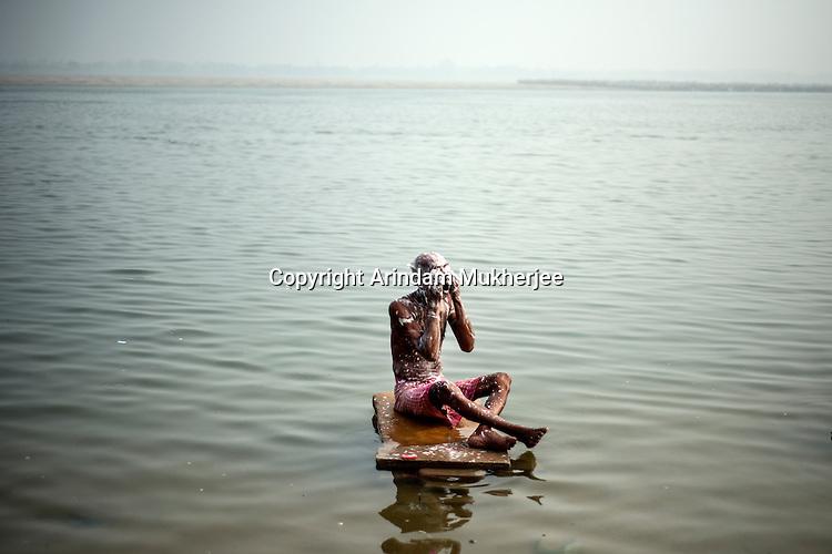A man washes up at a ghat in Varanasi, Uttar Pradesh, India.