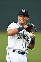 First baseman Jeremy Vasquez (20) of the Columbia Fireflies warms up before a game against the Augusta GreenJackets on Saturday, April 7, 2018, at Spirit Communications Park in Columbia, South Carolina. Augusta won, 6-2. (Tom Priddy/Four Seam Images)