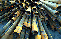 Sections of pipe used in offshore oil drilling and production.