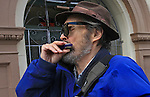 David plays his harmonica while strolling down Golden Gate Ave in the Tenderloin district of San Francisco, California.