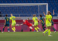 TOKYO, JAPAN - JULY 24: Hedvig Lindahl #1 of Sweden touches the ball as it crosses the line for a goal by Sam Kerr #2 of Australia during a game between Australia and Sweden at Saitama Stadium on July 24, 2021 in Tokyo, Japan.