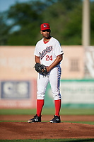 Auburn Doubledays starting pitcher Malvin Pena (24) gets ready to deliver a pitch during a game against the Batavia Muckdogs on June 15, 2018 at Falcon Park in Auburn, New York.  Auburn defeated Batavia 5-1.  (Mike Janes/Four Seam Images)