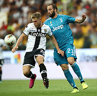 Calcio, Serie A: Parma - Juventus, Parma stadio Ennio Tardini, 24 agosto 2019. <br /> Parma's Luca Siligardi (l) in action with Juventus' Gonzalo Higuain (r) during the Italian Serie A football match between Parma and Juventus at Parma's Ennio Tardini stadium, August 24, 2019. <br /> UPDATE IMAGES PRESS/Isabella Bonotto