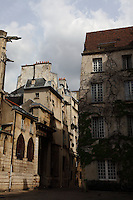 The beautiful corner at the back entrance of the church of Saint Gervais in the Marais, rue des Barres. The not vertical walls, the ivy, and the two gargoyles suggest the picturesque old fashioned atmosphere which is typical here.  There was a typical Parisian sky with sun and clouds, too.