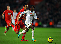 Saturday 10 November 2012<br /> Pictured: Nathan Dyer of Swansea (R) against Maya Yoshida of Southampton (L) scoring the equalising goal for his team<br /> Re: Barclay's Premier League, Southampton FC v Swansea City FC at St Mary's Stadium, Southampton, UK.