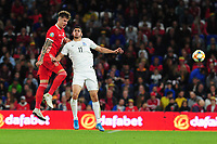 Joe Rodon of Wales vies for possession with Ramil Sheydayev of Azerbaijan during the UEFA Euro 2020 Qualifier match between Wales and Azerbaijan at the Cardiff City Stadium in Cardiff, Wales, UK. Friday 06, September 2019