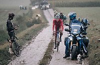 Niki Terpstra (NED/TotalEnergies) passing by a stranded Fernando Gaviria (COL/UAE-Emirates)<br /> <br /> 118th Paris-Roubaix 2021 (1.UWT)<br /> One day race from Compiègne to Roubaix (FRA) (257.7km)<br /> <br /> ©kramon