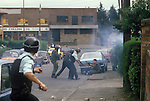 The Troubles. 1980s Belfast Northern Ireland. RUC and British Army under attach from catholic demonstrators. Police and army shooting reloading rubber bullets guns.