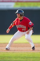 Michael Ortiz #21 of the Hickory Crawdads takes his lead off of second base against the Greensboro Grasshoppers at  L.P. Frans Stadium July 10, 2010, in Hickory, North Carolina.  Photo by Brian Westerholt / Four Seam Images