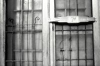 Screen door of abandoned building<br />