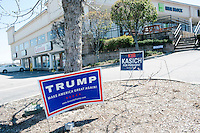 Campaign signs for Republican presidential candidates John Kasich and  Donald Trump are seen near the Airport Plaza strip mall in Warwick, Rhode Island, USA, on Sun., Apr. 24, 2016. The campaigns of Trump, Kasich, and Cruz, have set up their state operations in offices at Airport Plaza.