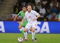 Wayne Rooney of England and Rafik Halliche of Algeria