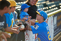 Myrtle Beach Pelicans Ethan Roberts (20) with his baby before a Carolina League game against the Potomac Nationals on August 14, 2019 at Northwest Federal Field at Pfitzner Stadium in Woodbridge, Virginia.  Potomac defeated Myrtle Beach 7-0.  (Mike Janes/Four Seam Images)