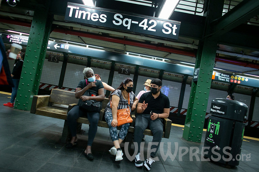 NEW YORK , NY JUNE 16: People sit together at a subway station the next day as the city mark the end of the COVID-19 restrictions in  New York on June 17 2021. <br /> (Photo by Kena Betancur/VIEWpress)