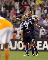 New England Revolution forward Khano Smith (18) celebrates goal by New England Revolution forward Ilica Stojica (9). The New England Revolution defeated Houston Dynamo, 1-0, at Gillette Stadium on August 14, 2010.