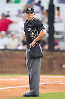 Home plate umpire Brock Ballou between innings of the Appalachian League game between the Elizabethton Twins and the Johnson City Cardinals at Cardinal Park on July 27, 2014 in Johnson City, Tennessee.  The game was suspended in the top of the 5th inning with the Twins leading the Cardinals 7-6.  (Brian Westerholt/Four Seam Images)