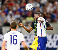 DALLAS, TX - JULY 25: Shaq Moore #20 of the United States heads the ball over Cory Burke #9 of Jamaica during a game between Jamaica and USMNT at AT&T Stadium on July 25, 2021 in Dallas, Texas.