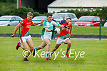 Kevin Goulding of Ballyduff goal bound as  Matthew O'Sullivan and St Michaels Foilmore in the County Senior football league.