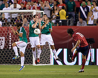 Jose Torres (11) of the USMNT fires a free kick towards Andres Guardado (18), Gerardo Torrado (6) and Israel Castro (8) of Mexico during the game at Lincoln Financial Field in Philadelphia, PA. The USMNT tied Mexico, 1-1.