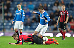 Rangers v St Johnstone....28.10.14   Scottish League Cup Quarter Final at Ibrox<br /> Ian Black sends Chris Millar flying<br /> Picture by Graeme Hart.<br /> Copyright Perthshire Picture Agency<br /> Tel: 01738 623350  Mobile: 07990 594431