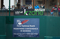"""Fans hang """"K"""" signs in the """"Cricket Wireless K-Zone"""" after each strikeout by a Greensboro Grasshoppers pitcher during the game against the Rome Braves at First National Bank Field on May 16, 2021 in Greensboro, North Carolina. (Brian Westerholt/Four Seam Images)"""