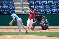 Clearwater Threshers catcher Chace Numata (50) hits a pitch from Hunter Wood (3) while at bat in front of catcher Mac James (8) and umpire Mike Savakinas during a game against the Charlotte Stone Crabs on April 13, 2016 at Bright House Field in Clearwater, Florida.  Charlotte defeated Clearwater 1-0.  (Mike Janes/Four Seam Images)