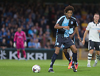 Sido Jombati of Wycombe Wanderers passes the ball during the Capital One Cup match between Wycombe Wanderers and Fulham at Adams Park, High Wycombe, England on 11 August 2015. Photo by Andy Rowland.