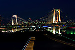 Japan, Tokyo, Odaiba, Rainbow Bridge at Dusk (Zoom Effect)