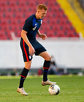 GUADALAJARA, MEXICO - MARCH 28: Justen Glad #4 of the United States moves steps over the ball during a game between Honduras and USMNT U-23 at Estadio Jalisco on March 28, 2021 in Guadalajara, Mexico.