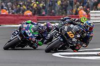 29th August 2021; Silverstone Circuit, Silverstone, Northamptonshire, England; MotoGP British Grand Prix, Race Day; Sky VR46 Esponsorama Rider Luca Marini on his Ducati Desmosedici GP19 dives down the inside of Sky VR46 Esponsorama Rider Enea Bastianini on his Ducati Desmosedici GP19