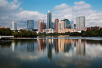 This is the serene Austin Skyline looking west as shot from the Boardwalk Trail on Lady Bird Lake. The Boardwalk Trail at Lady Bird Town Lake connects the current end of the hike and bike trail by the Austin American Statesman Building to Lakeshore Park, closing the southeastern gap of the hike and bike trail. Now pedestrians, runners and bikers are able to complete the 10.1 mile trail loop without obstruction.