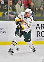 27 January 2012: University of Vermont Catamount forward Kyle Mountain, a Freshman from Bryn Mawr, PA, takes a wrist shot to score his first career goal at 13:45 of the second period against the Northeastern University Huskies at Gutterson Fieldhouse in Burlington, Vermont. The Catamounts fell to the Huskies 8-3 in the first game of their 2-game Hockey East weekend series. Mandatory Credit: Ed Wolfstein Photo
