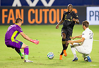 CARSON, CA - SEPTEMBER 06: Bradley Wright-Phillips #66 of LAFC dribbles between David Bingham #1 GK and Nicholas DePuy #20 of the Los Angeles Galaxy during a game between Los Angeles FC and Los Angeles Galaxy at Dignity Health Sports Park on September 06, 2020 in Carson, California.