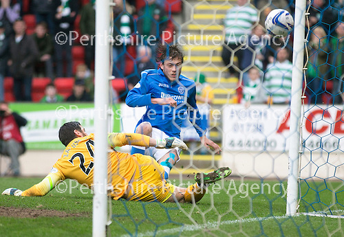 St Johnstone v Celtic...15.05.15   SPFL<br /> Lukasz Zaluska saves from Murray Davidson<br /> Picture by Graeme Hart.<br /> Copyright Perthshire Picture Agency<br /> Tel: 01738 623350  Mobile: 07990 594431